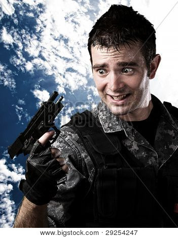 portrait of a young soldier reload fail against a cloudy sky background