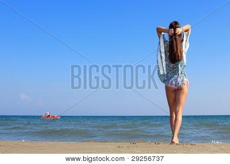 girl on the beach enjoying the ocean view