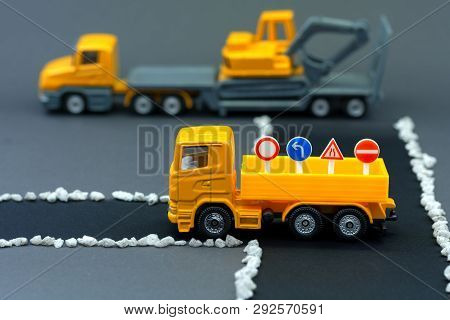 Diorama Road Construction With Yellow Construction Machinery Models
