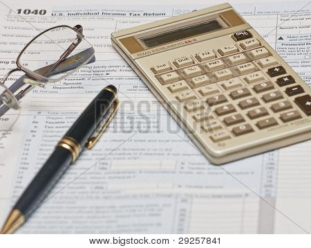 1040 Form With Calculator And Pen
