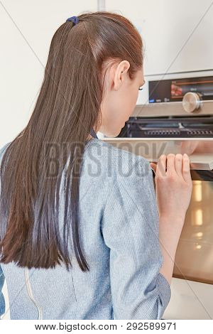 Beautiful Woman In The Kitchen, Waiting With The Front Of The O
