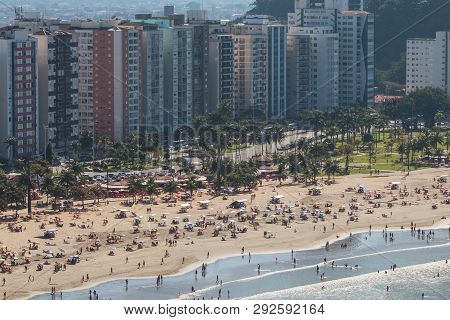 Sao Vicente, Brazil - July 2018:  High-angle View Of Hundreds Of People Enjoying The Beach On A Sund