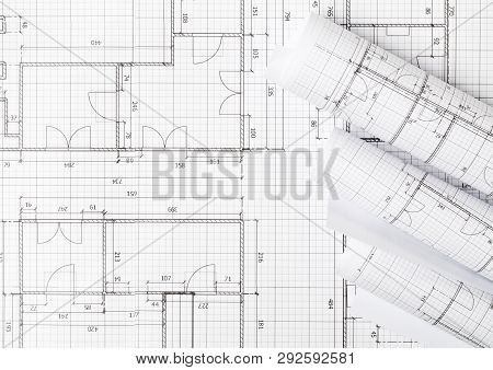 Rolls Of Architectural Blueprint House Building Plans On Blueprint Background On Table Flatlay Top V
