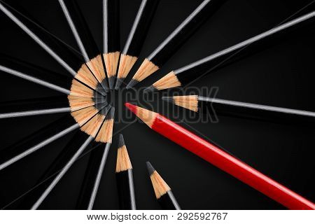 Business concept of disruption, leadership or think different; red pencil breakign apart circle of black pencils; minimal concept flat lay from above on black background poster