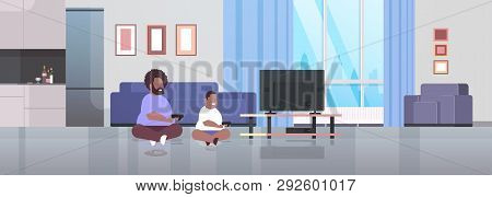 Fat Obese Father With Son Holding Joystick Game Pad Overweight Family Plying Video Games On Tv Scree
