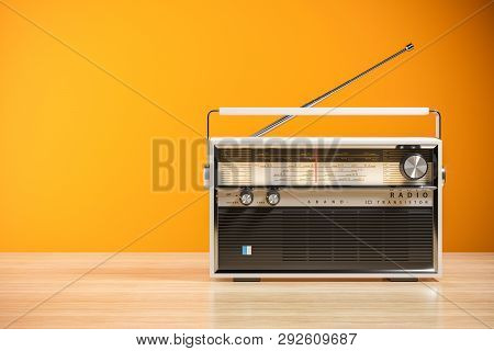 Portable Orange Transistor Radio Receiver. Isolated On White Background 3d Render