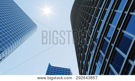 Low Angle View Of Skyscrapers. Skyscrapers Looking Up Perspective. Bottom View Of Modern Skyscrapers