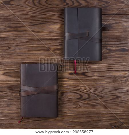 Black And Brown Handmade Leather Notebook Cover With Notebook On Wooden Background. Stock Photo Of L
