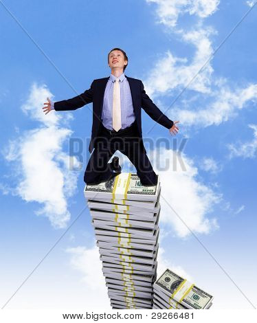 Young businessman with money symbols