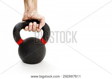 Hand holding kettlebell on white background
