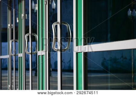Chrome Door Handle And Glass Of Modern Aluminium Office Facade
