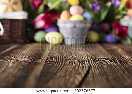 Easter Background. Rustic Wooden Table. Tulips And Spring Flowers. Easter Eggs. Green Bokeh. Place F
