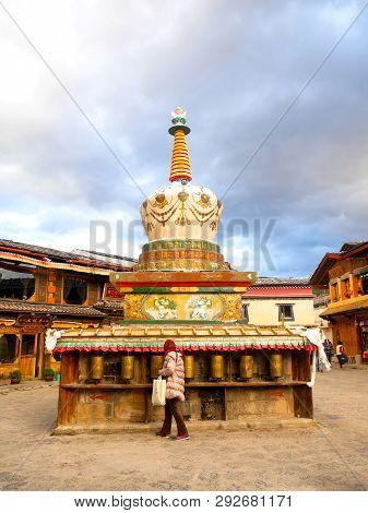 Shangri-la, China - October 18, 2018: A Tourist Turns A Prayer Wheel In Shangri-la Old Town, Yunnan,