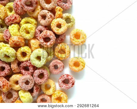 Pile of colorful fruity breakfast cereal isolated on white background. Top view. poster