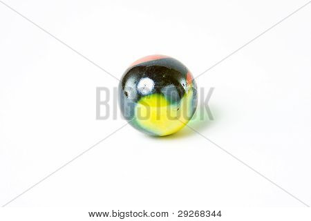 Wonderful Multicolored glass Marble white background yellow orange black