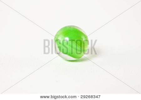Light Green glass Marble on a white background