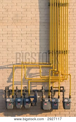 Natural Gas Meters Maze On A Brick Wall