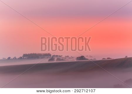 Amazing Nature Landscape In Morning Fog Sunrise. Autumn Scenic Landscape Of South Moravia In Czech R