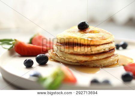 Sweet Breakfast. Pancakes With Strawberries, Blueberries And Maple Syrup. Sweet Breakfast.