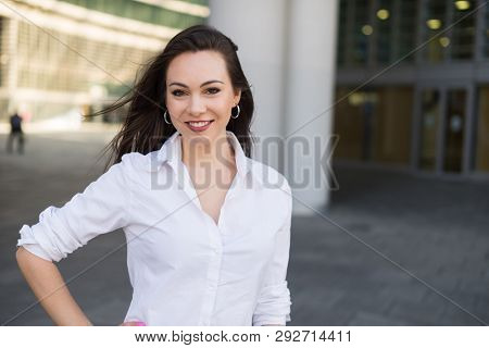 Smiling young woman in a business environment