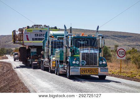Western Australia - July 11, 2019: Two Green Kenworth T327 Heavy Trucks Of The Toll Company Transpor
