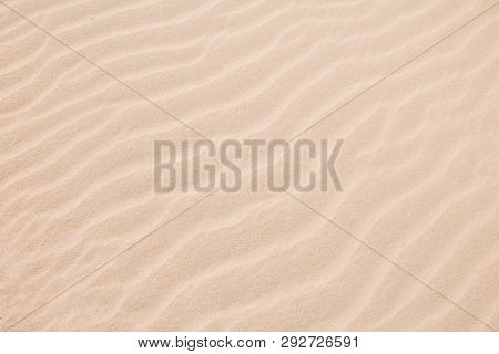 Beautiful Nature Sandy Summer Background. Abstract Pattern Of Wave Sand On Beach Formed By Wind. Lig