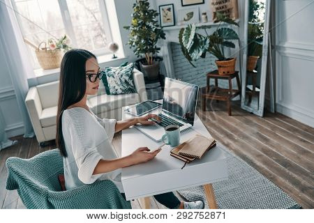 Working From Home. Top View Of Beautiful Young Woman Working Using Laptop While Sitting In Home Offi