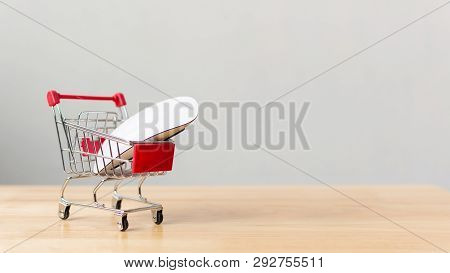 Online Shopping And Ecommerce Transport Logistics Delivery Service Concept. Computer Mouse On Shoppi