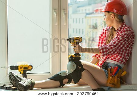 Pretty Young Woman Construction Worker With Helmet About To Fix Window Picking Best Tools. Working A