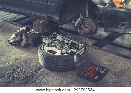 Car Brake Repairing In Garage, Brakes On A Car With Removed Wheel, Car Brake Part At Garage, Car Bra