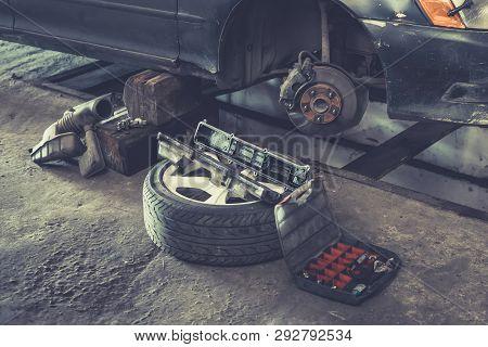 Car Brake Repairing In Garage, Brakes On A Car With Removed Wheel, Car Brake Part At Garage, Car Bra