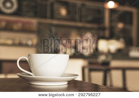 A Cup Of Coffee Time In Cafe Blurred Background.
