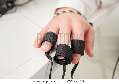 Mans Hands On Which Polygraph Sensors Are Worn.