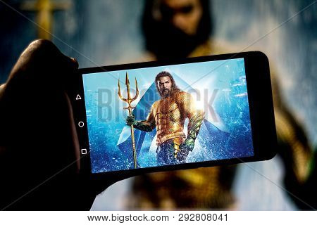 April 1, 2019, Brazil. Aquaman Movie On The Screen Of The Mobile Device. Aquaman Is An American Film