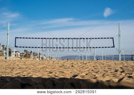 Manhattan Beach, California - March 26, 2019: Beach Volleyball Nets Set Up In The Sand. Manhattan Be