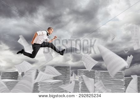 Businessman Runs Away From The Worksheets And Bureaucracy