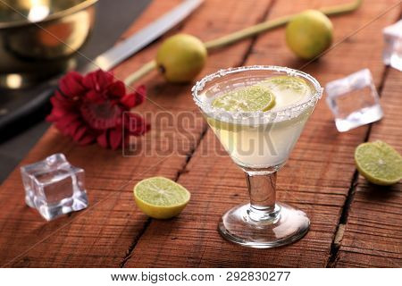 Cold Drink Lemonade In A Glass On A Wooden Background