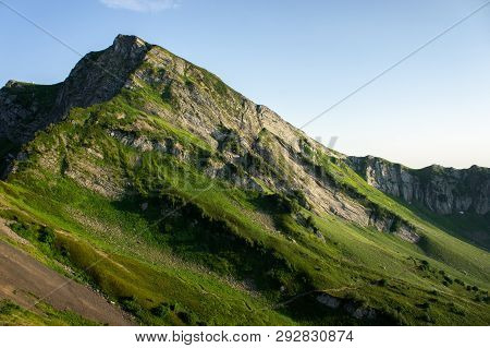 Top View Of The Mountain Range And Peaks. Mountain Peak In The Summer.