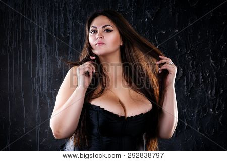 Sexy Plus Size Model In Black Corset, Fat Woman With Big Natural Breasts On Dark Background, Body Po