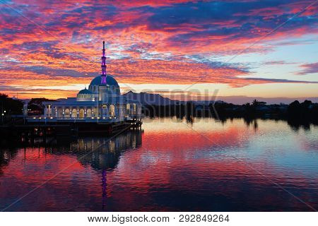 Scenic View Of Floating Mosque On Sarawak River With Colorful Sunset Clouds Background. Waterfront L