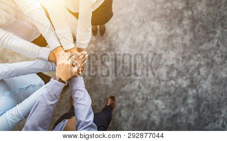 Close Up Top View Of Young Business People Putting Their Hands Together. Stack Of Hands. Unity And T