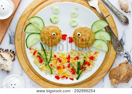 Fish Meatballs With Porridge And Vegetable Slices For Funny And Healthy Dinner For Kids, Food Art Co