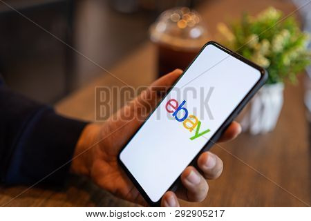 Chiang Mai, Thailand - Mar. 24,2019: Man Holding Xiaomi Mi Mix 3 With Ebay Apps On The Screen. Ebay