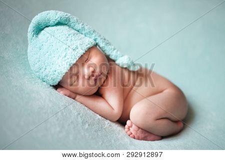 Newborn Baby Asian Boy Sleeping At Blue Background