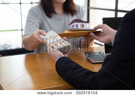 Women holding contract and document about home mortgage submit to bank and received money poster
