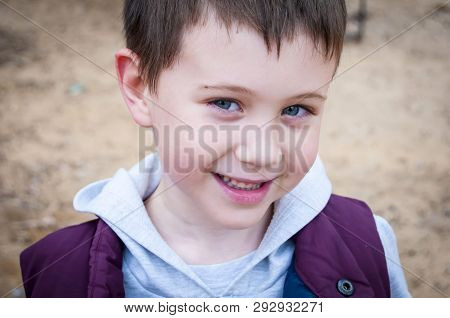 Cute First Grader Smiling Caucasian Boy Close Up Portrait. First Time To School, A 7 Year Old Child