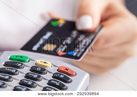Paying With Credit Card. Female Inserting Chip Card Into Payment Terminal Device