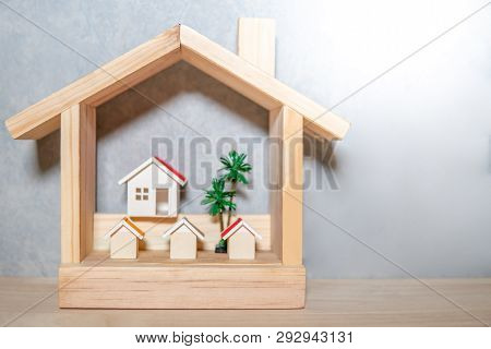 Real Estate Or Property Investment. Residential Building Development. Group Of House Models And Tree