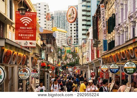 Chinatown, Singapore - February 8, 2019: Crowded Street With Street Food In Chinatown Against Centra