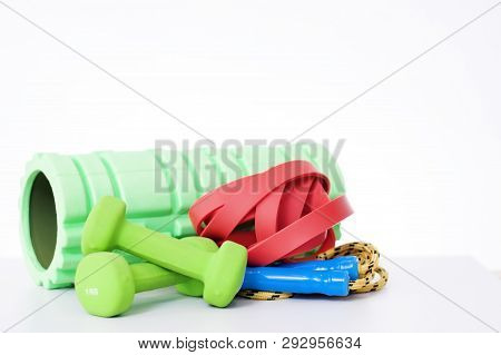 Home Fitness Equipment Isolated On White Background. Foam Roller, Elastic Band,jump Rope, Dumbbell F